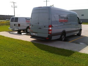 Two Parked Thompson Vans
